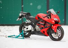 KRASNOYARSK, RUSSIA - March 18, 2019: Red and black sportbike Honda CBR 600 RR 2005 PC37 in winter. The bike is on the snow.  stock images