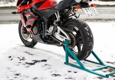 KRASNOYARSK, RUSSIA - March 18, 2019: Red and black sportbike Honda CBR 600 RR 2005 PC37 in winter. The bike is on the snow.  stock photography