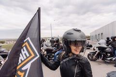 Free Krasnoyarsk, Russia - May 16, 2020: Harley Davidson Free Ride Outdoor. Biker Girl With Helmet Standing Royalty Free Stock Photography - 185069207