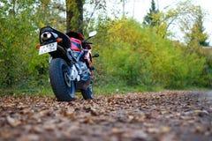 KRASNOYARSK, RUSSIA - SEPTEMBER 1, 2017: Red and black sportbike Honda CBR 600 RR 2005 PC37. Autumn yellow leaves.  royalty free stock photo