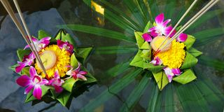 Krathong ,hand crafted floating basket by banana leaf,decorated with flowers and incense sticks, candle, Stock Photography