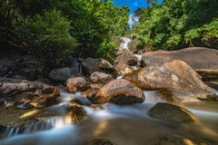 Krating Waterfall at Chantaburi province in Thailand. Very beautiful and smooth water with orange rock and tree and high contrast. Waterfall in Nationpark royalty free stock photography