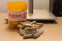 Kratom pills on a desk. Image of actual kratom pills with a faux prescription logo Stock Photography