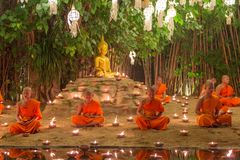 Kratong Festival, Buddhist monk fire candles to the Buddha and floating lamp on in Phan Tao Temple Stock Photos