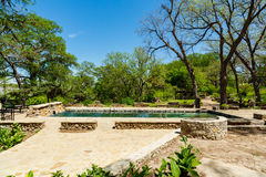Krause Springs Pool. Spicewood, Texas USA - April 5, 2016: Krause Springs is a popular tourist destination with camping and swimming activities in the Texas Hill stock photography