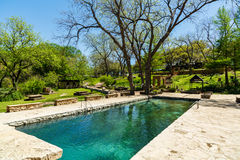 Krause Springs Pool. Spicewood, Texas USA - April 5, 2016: Krause Springs is a popular tourist destination with camping and swimming activities in the Texas Hill stock image