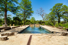 Krause Springs Pool. Spicewood, Texas USA - April 5, 2016: Krause Springs is a popular tourist destination with camping and swimming activities in the Texas Hill royalty free stock images