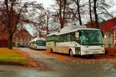 Kravare, Machuv kraj, Czech republic - october 29, 2016: white CSAD buses parked at a bus stop during the autumn tourist season Royalty Free Stock Photo