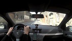 Kravare, República Checa - 14 de abril de 2017: conducción del coche Opel Astra H en el pueblo Kravare en área turística del kraj almacen de metraje de vídeo