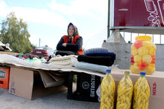 KRAVARI, MACEDONIA. 8 OCTOBER 2016- Older women selling hand-made socks and preserved vegetables on the road near the border. Picture of a KRAVARI, MACEDONIA. 8 royalty free stock photos