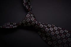 Krawat na ciemnym tle Fotografia Royalty Free