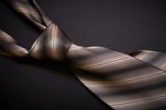 Krawat na ciemnym tle Obrazy Stock