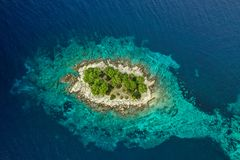 Beautiful drone view of small island Krbelica, Dalmatia, Croatia royalty free stock photos