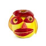 Kreative Mündung von zwei Äpfeln unterschiedlicher Farbe Lizenzfreie Stockfotografie