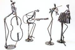 Kreative Zahlen von Musikern, Violoncellist, Gitarrist, violini Lizenzfreie Stockfotos