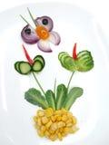 Kreativer lustiger Gemüsesnack mit Gurke Stockfotografie