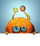Kreatives lustiges orange Monster Lizenzfreies Stockbild