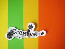 Kreatives Wort geschnitten vom Papier Lizenzfreie Stockbilder