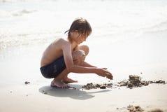Kreativität auf dem Strand Stockbild