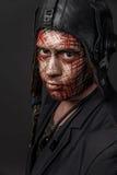 Kreatywnie i Śmieszny wojskowy Projektuje kamuflaż na czołgista twarzy Obraz Stock