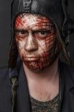 Kreatywnie i Śmieszny wojskowy Projektuje kamuflaż na czołgista twarzy Fotografia Stock
