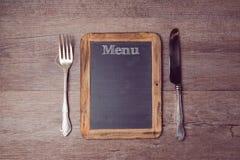 Kreatywnie menu tło z chalkboard i silverware na widok Obrazy Royalty Free