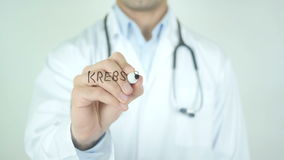 Krebs Stoppen, Stop Cancer in German Writing on Glass. Man writing stock video footage