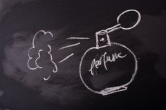 Kreda rysujący pachnidło na blackboard obraz royalty free