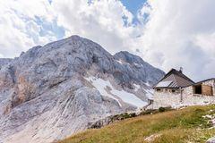Kredarica - highest mountain hut in Slovenia and climb to Mt. Tr. Iglav in the background Stock Images