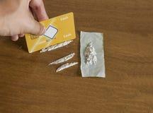 Kreditering och kokain Royaltyfria Bilder