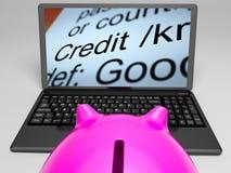 Krediteringsdefinition på bärbara datorn som visar finansiell hjälp Royaltyfri Bild