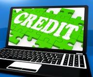 Krediteringspusslet på anteckningsboken visar online-köp Arkivfoto