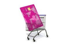Kreditkarte in einem Supermarktwarenkorb auf weißem Hintergrund Lizenzfreie Stockbilder