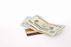 Kreditkarte und Dollar Stockfotos