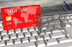 Kreditkarte und Warenkörbe auf Computertastaturnahaufnahme Lizenzfreie Stockbilder