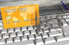 Kreditkarte und Warenkörbe auf Computertastaturnahaufnahme Stockbild