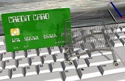 Kreditkarte und Warenkörbe auf Computertastaturnahaufnahme Stockfotos