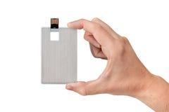 Kreditkarteflash-speicher an Hand mit lokalisiertem weißem Hintergrund Stockbild