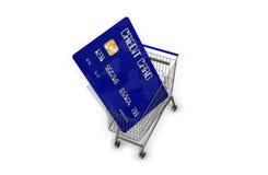 Kreditkort i en supermarketshoppingvagn på vit bakgrund Arkivfoto