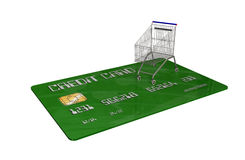 Kreditkort med en shoppingvagn på vit bakgrund Fotografering för Bildbyråer