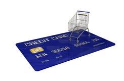 Kreditkort med en shoppingvagn på vit bakgrund Arkivbild