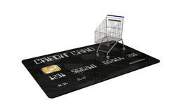 Kreditkort med en shoppingvagn på vit bakgrund Arkivfoton