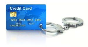 Kreditkort med handbojor Arkivbild