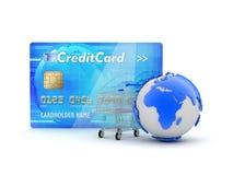 Kreditkort, shoppa vagn och jordjordklot Fotografering för Bildbyråer