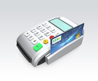 Kreditkort som nallar till och med en kortläsare på grå bakgrund Royaltyfria Bilder