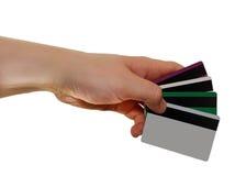 Kreditkortar i hand Arkivbild
