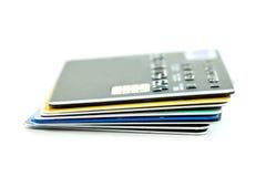 Kreditkortar många som tillsammans staplas Royaltyfri Bild