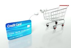 Kreditkortbetalning med shoppingvagnen Arkivfoton
