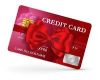 Kredyt lub karta debetowa projekt z czerwonym faborkiem i łękiem Fotografia Royalty Free