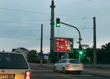 Krefeld 26th 2018: Coca Cola billboard shot at traffic light with car in motion royalty free stock photos